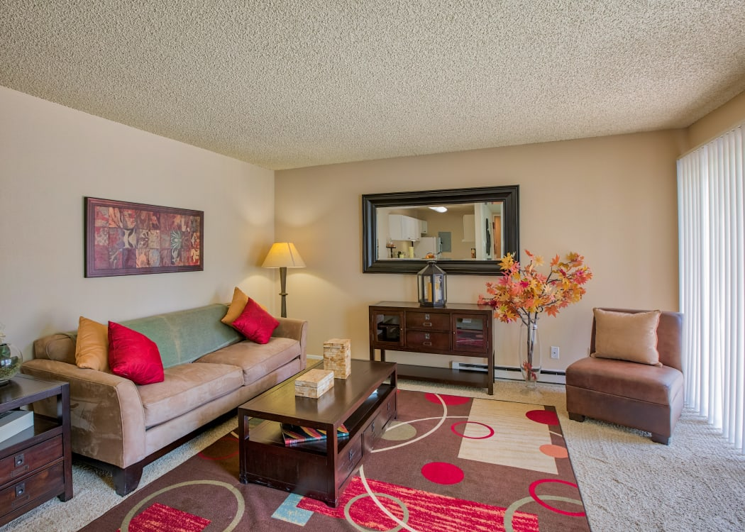 Open bright living room at The Knolls at Sweetgrass Apartment Homes