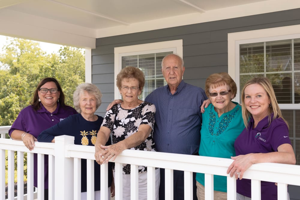 senior residents posing for a photo on porch