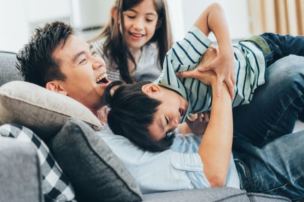 A family having fun in their new apartment at Lakeview Townhomes at Fox Valley in Aurora, Illinois