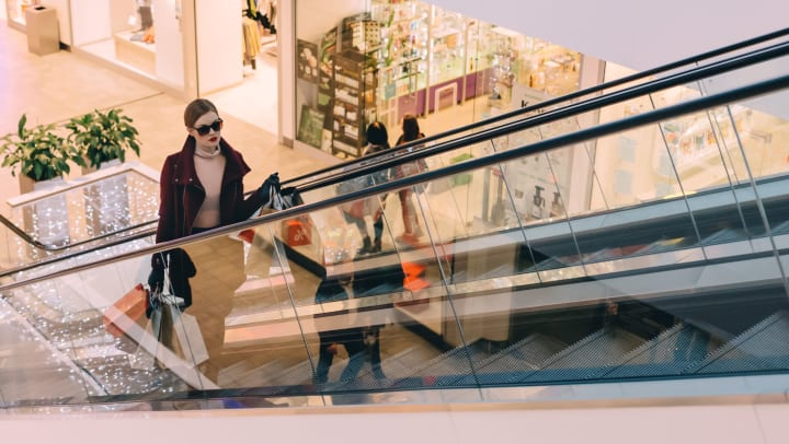 Shopper riding an escalator at a nearby mall at Canopy at Citrus Park in Tampa, Florida
