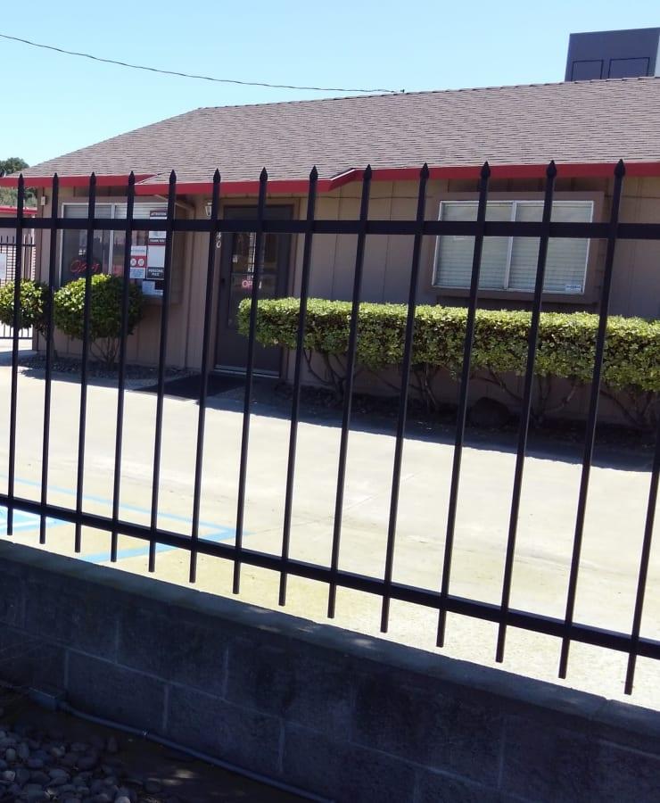 Fenced exterior of StorQuest Self Storage in Ripon, California