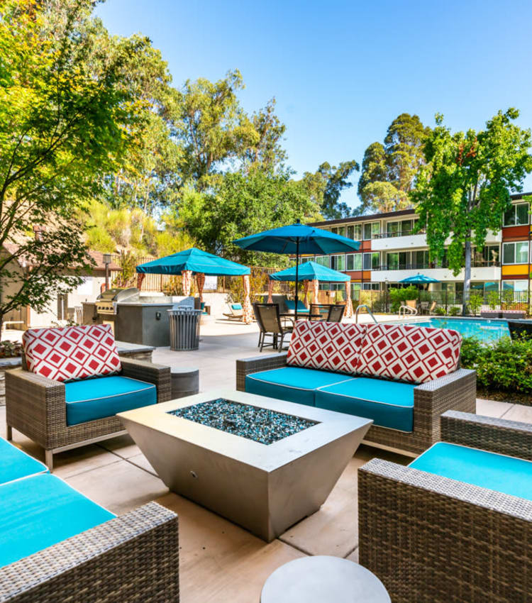 Barbecue area with a gas grill for resident use near the swimming pool at Sofi Belmont Glen in Belmont, California