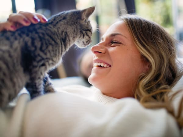 Resident and her happy cat in their pet-friendly home at Harrison Tower in Portland, Oregon