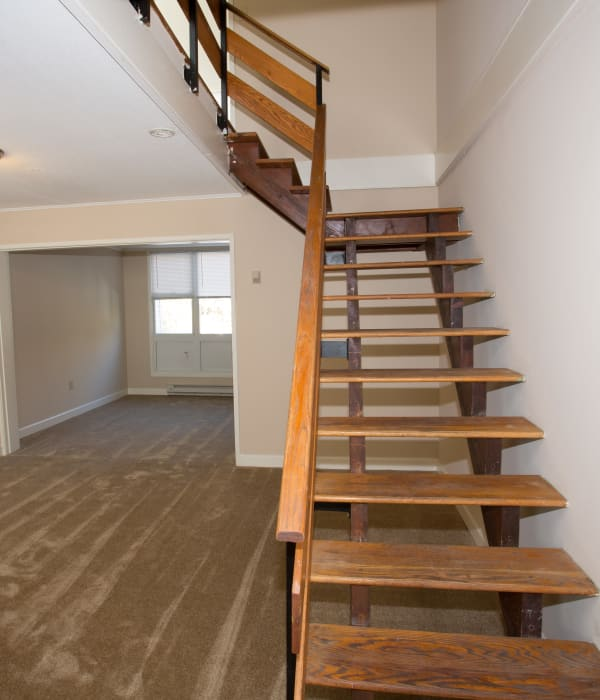 Hardwood stairs leading to apartment upstairs at Cortlandt Ridge in Ossining, New York