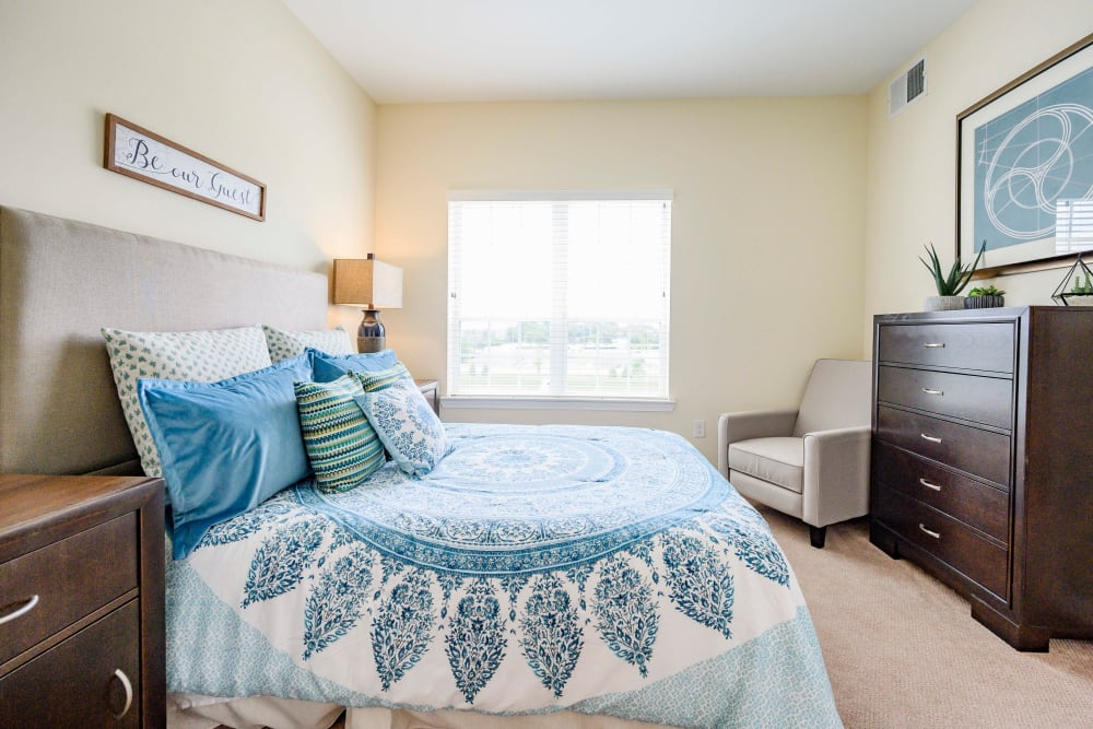 A large furnished bedroom at Harmony at Victory Station in Murfreesboro, Tennessee