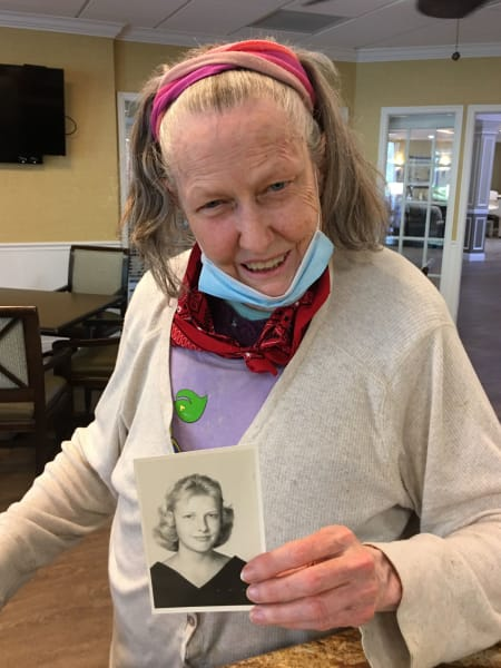 Barkley Place residents show off their old school photos.