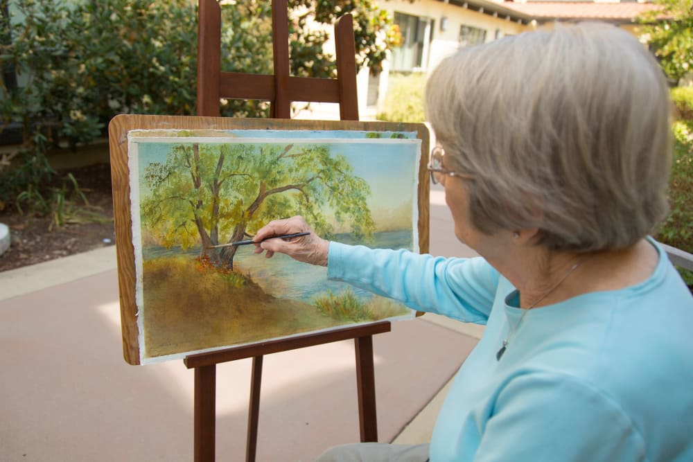 Resident painting at Merrill Gardens at Campbell