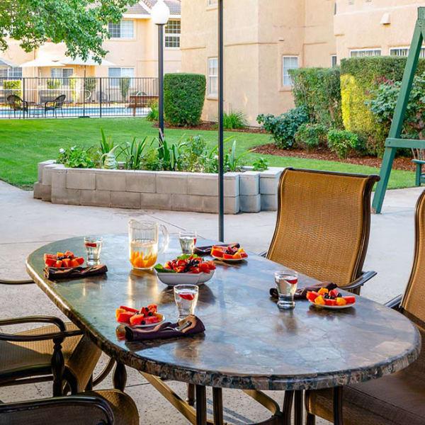 Gorgeous outdoor dining at Pacifica Senior Living Fresno in Fresno, California.