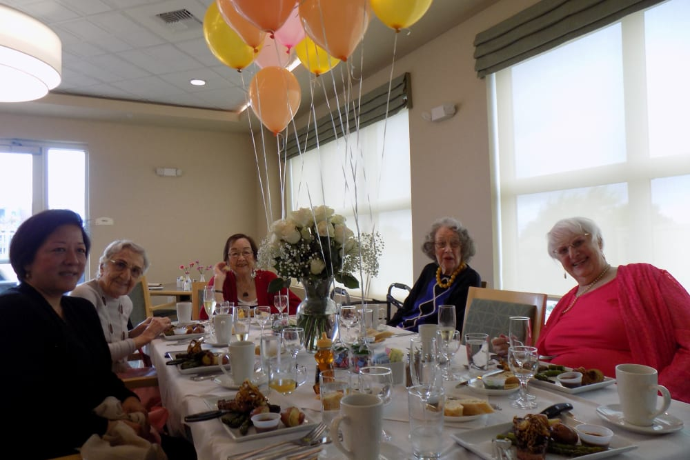 Residents enjoying their May birthday lunch at Merrill Gardens at Rockridge in Oakland, California.
