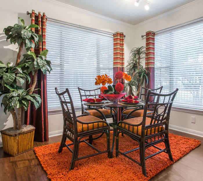 Dining area with hardwood floors in model home at Riata in Austin, TX