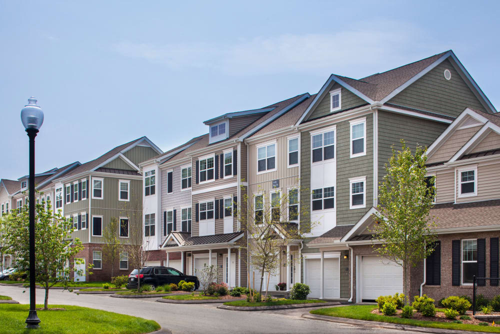 Townhome exteriors with attached garages at Prynne Hills in Canton, Massachusetts