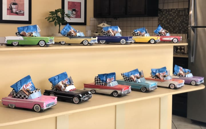 Team members worked hard to figure out each residents favorite classic car for their custom goody bags.