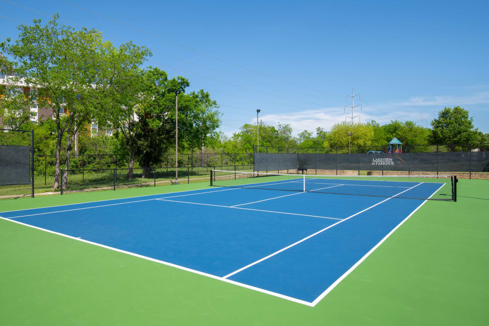 Enjoy Apartments with a Tennis Court at Lakeview at Parkside in Farmers Branch, Texas