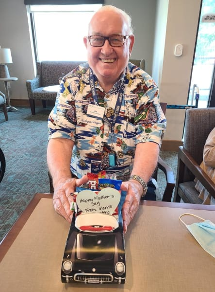 A West Covina (CA) resident shows off his classic car-themed goody bag.