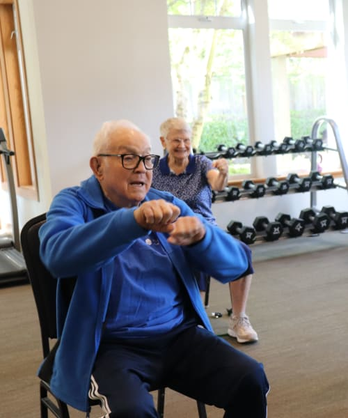 Residents participating in exercise class of The Springs at Clackamas Woods in Milwaukie, Oregon