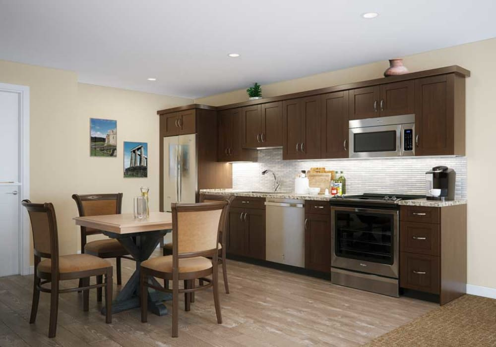 A kitchen with wood flooring in an apartment at Touchmark on West Century in Bismarck, North Dakota