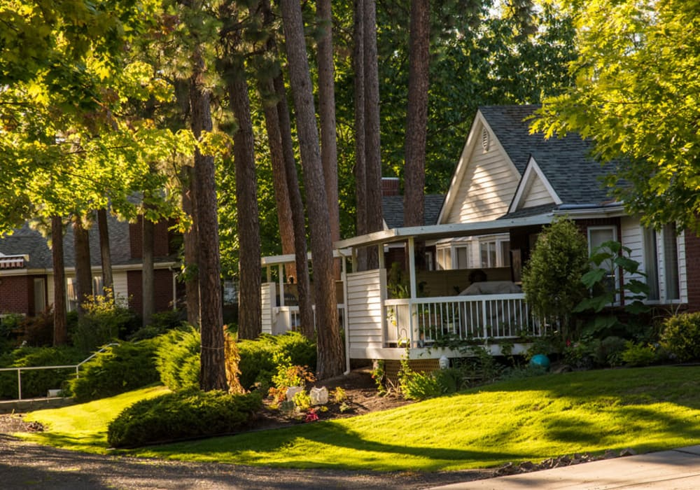 A cottage surrounded by trees at Touchmark on South Hill in Spokane, Washington