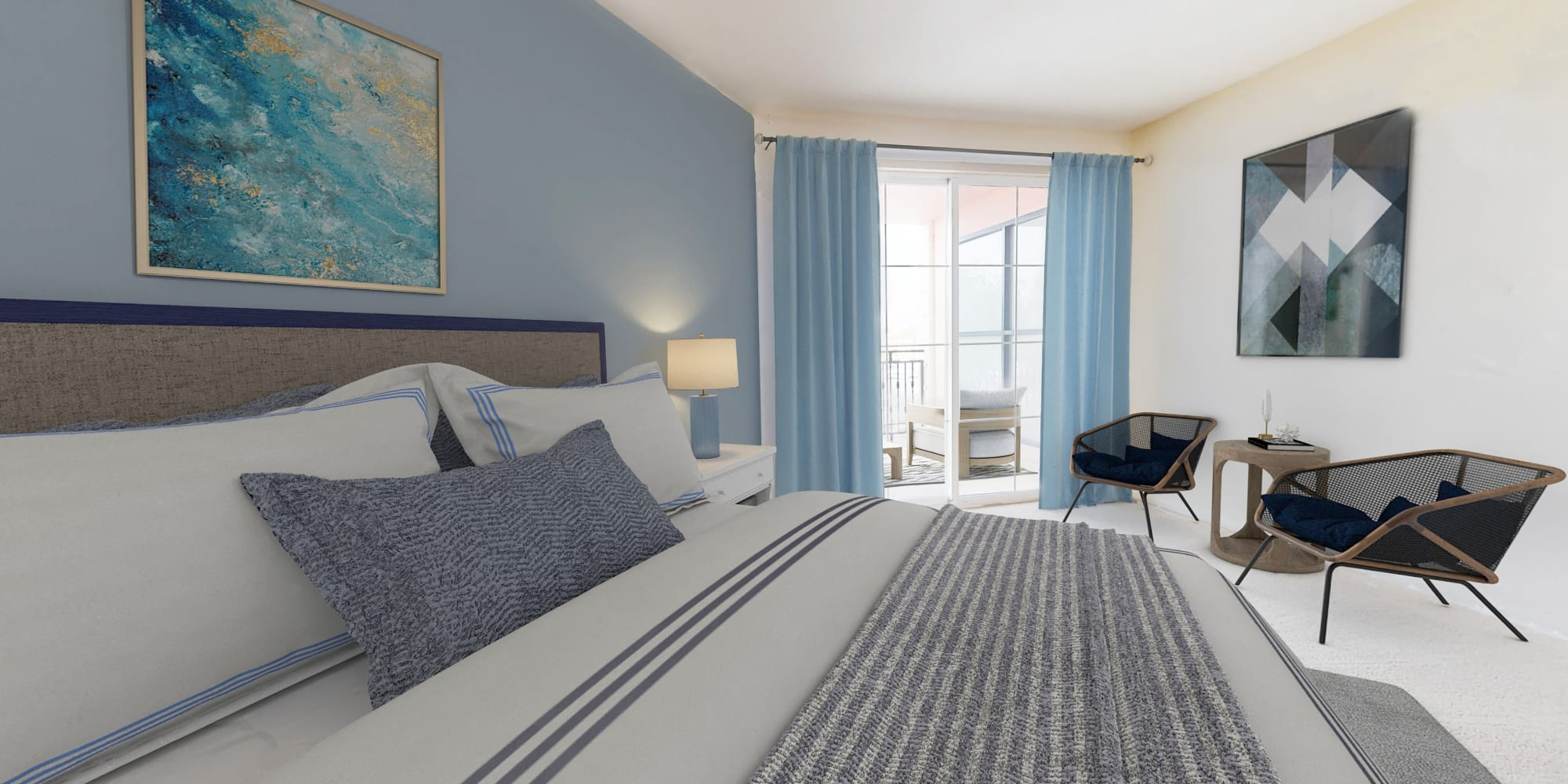 Extra large bedroom with sitting area and balcony overlooking the waterfront marina at The Villa at Marina Harbor in Marina del Rey, California