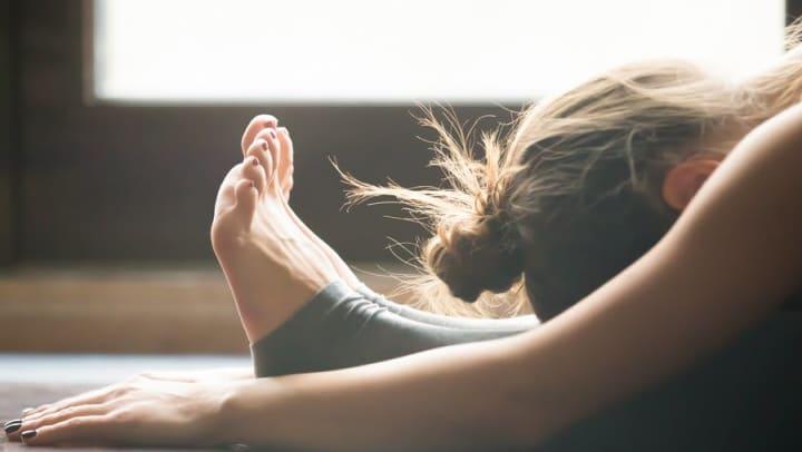 Woman in yoga pose at Olympus at Daybreak in South Jordan, Utah