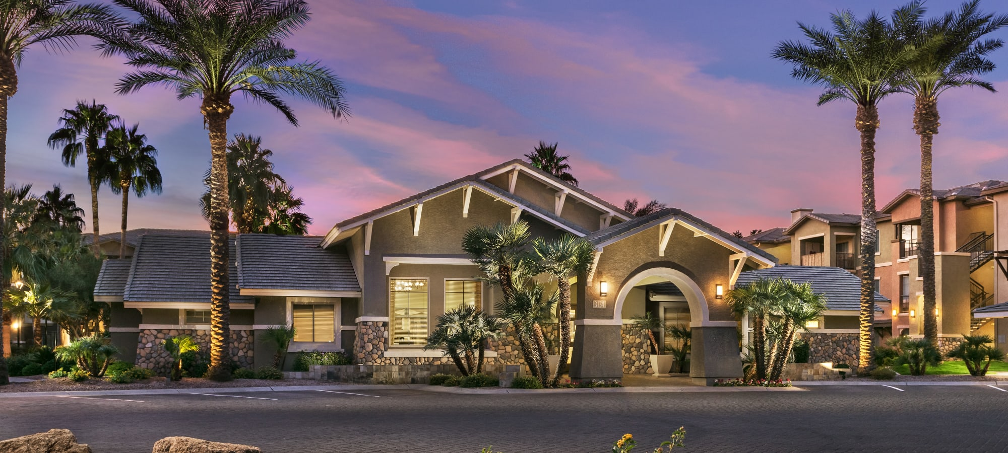 Stunning exterior of leasing office at Azul at Spectrum in Gilbert, Arizona during sunset