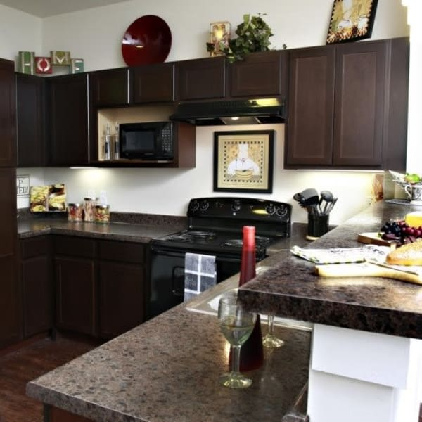 Kitchen with granite counters at The Marquis Apartment Homes in New Orleans, Louisiana
