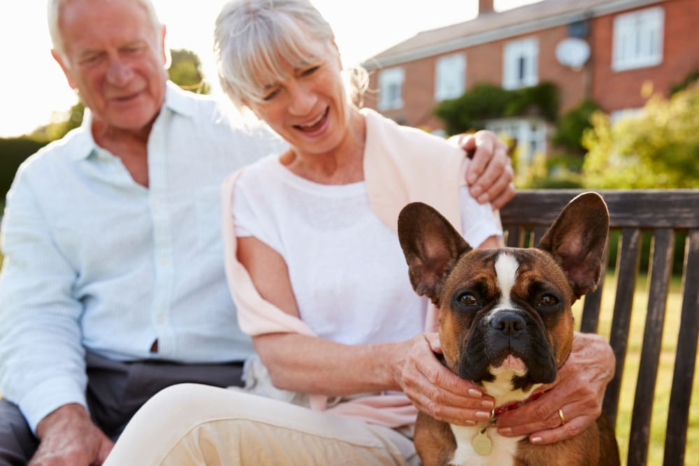 A resident couple with their dog at Regency Palms Colton in Colton, California.