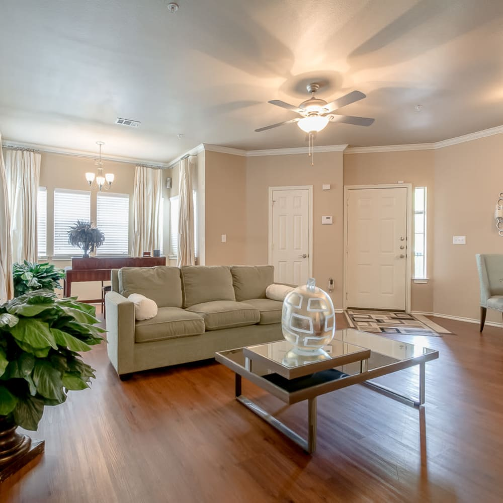 Large living room with an entryway closet at Alon at Castle Hills in San Antonio, Texas