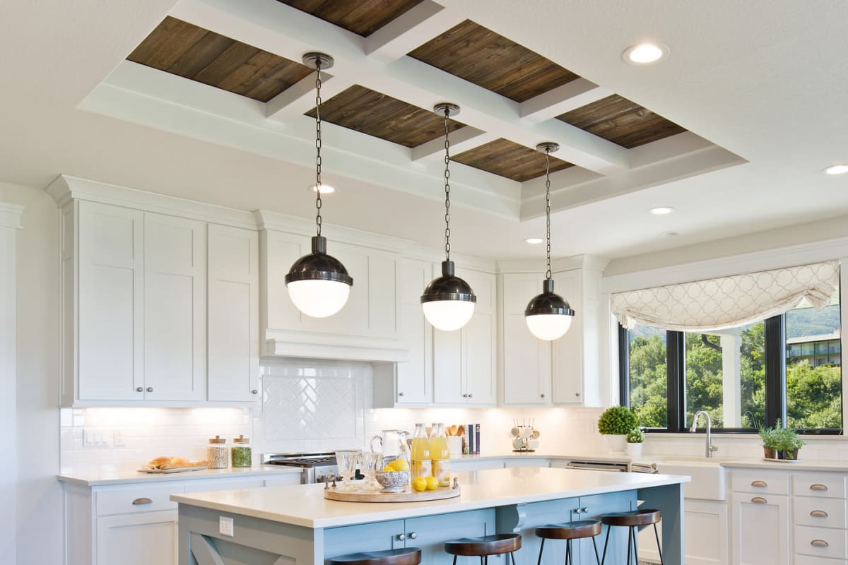 Pendant lighting in a model home's kitchen at Solera at City Centre in Palm Beach Gardens, Florida