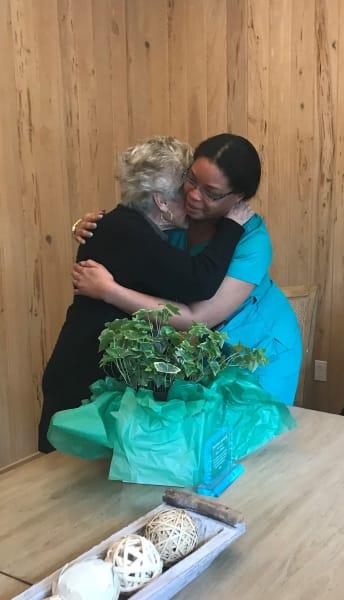 resident hugging family member