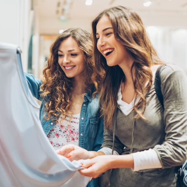 Resident mother and daughter out for some retail therapy at a clothing boutique near Bonterra Apartments in Fort Wayne, Indiana