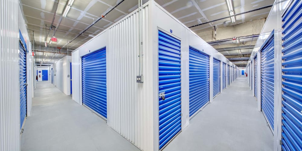 Indoor climate controlled units with blue doors at Seaport Storage in Tampa, Florida