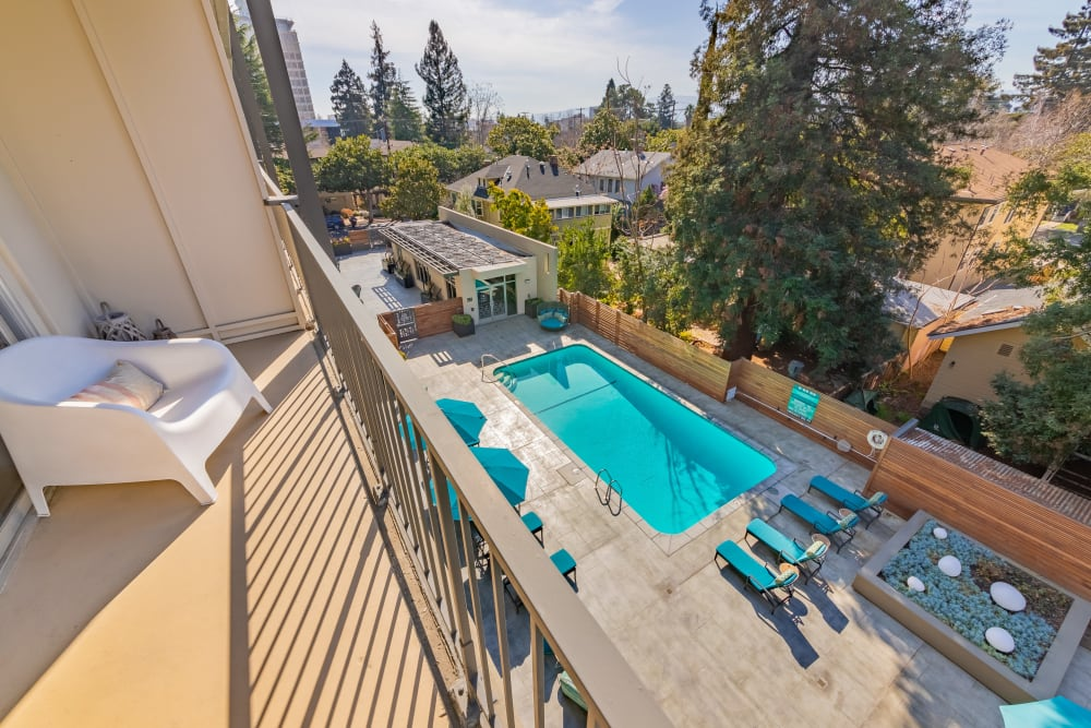Private balcony at our luxury apartments in Palo Alto overlooking community swimming pool