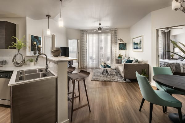 Beautiful open-concept layout with hardwood floors in a model home at Park Place at Fountain Hills in Fountain Hills, Arizona