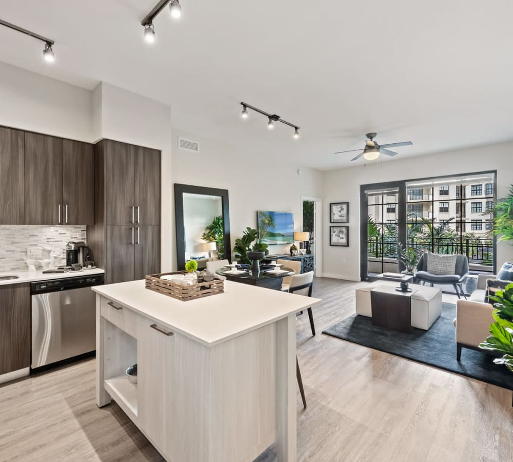 Spacious kitchen with breakfast bar and dark gray cabinets at 6600 Main in Miami Lakes, Florida