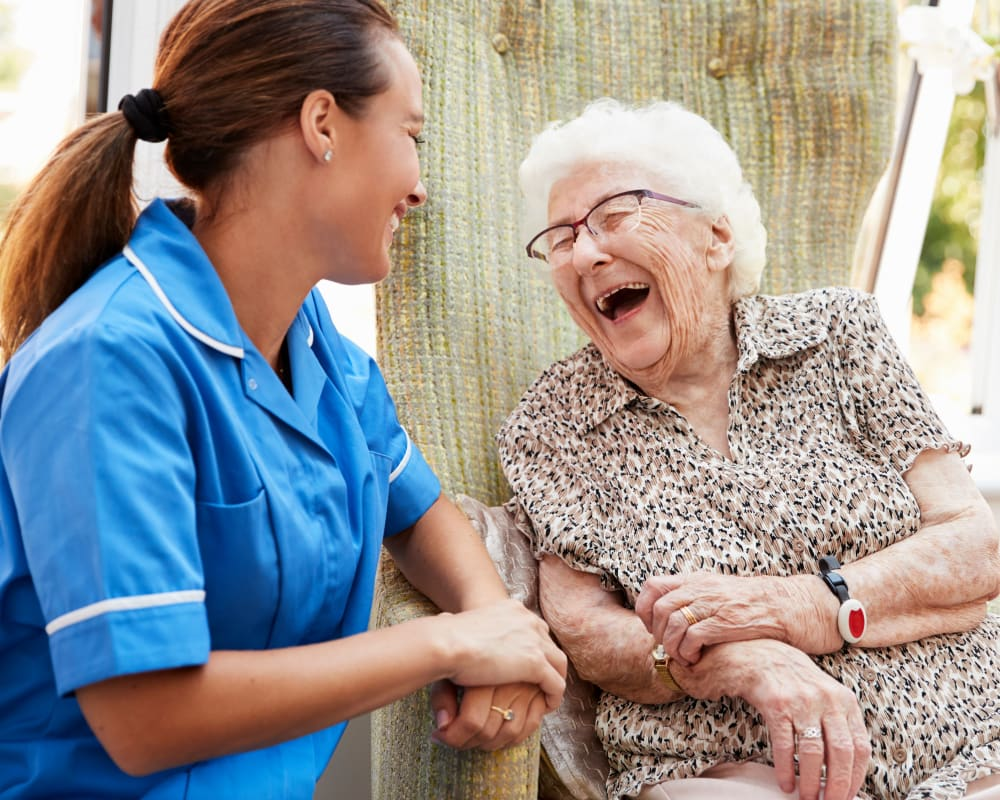 Resident laughing with a caretaker at Governor's Port in Mentor, Ohio
