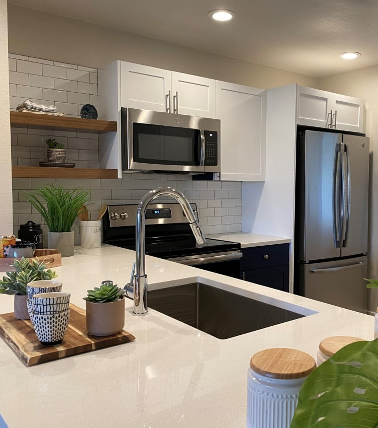Chef-inspired kitchen with quartz countertops in a model home at Harbor Point Apartments in Mill Valley, California