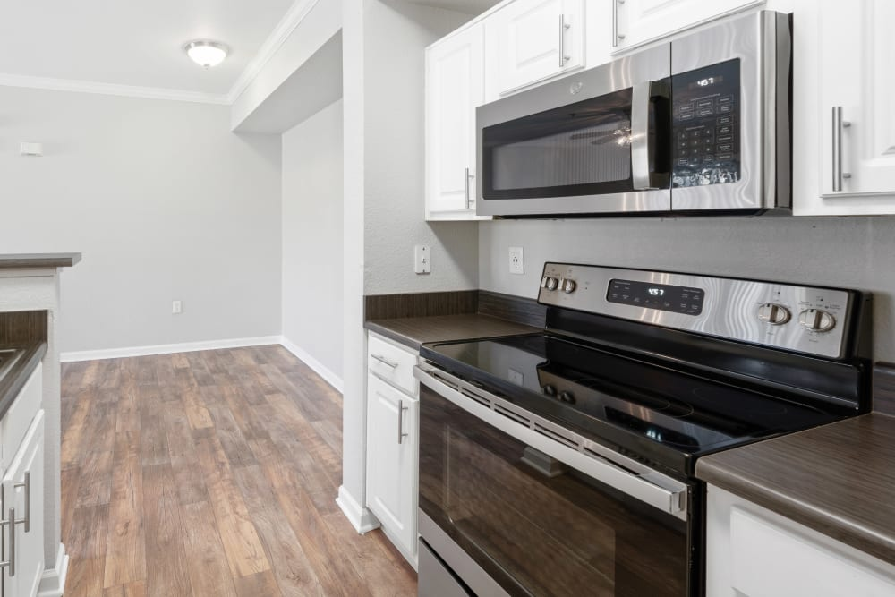 Apartment kitchen with stainless-steel appliances at River Oaks Apartment Homes in Vacaville, California