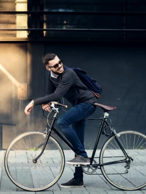 A man biking to work from his apartment at Kestrel Park in Vancouver, Washington