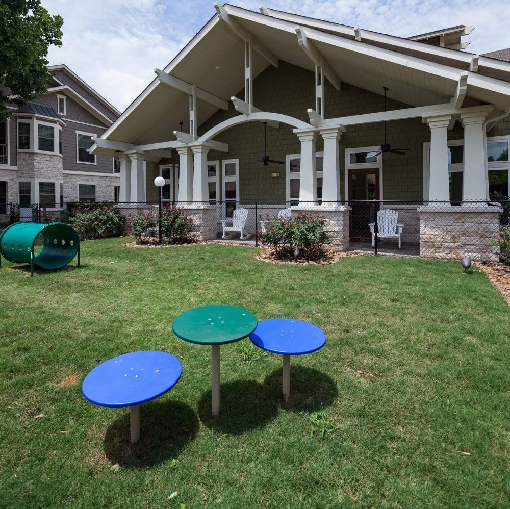 Grassy onsite dog park at Lakefront Villas in Houston, Texas