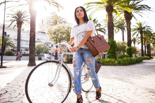 Resident walking her bike near Palo Alto Plaza in Mountain View, California