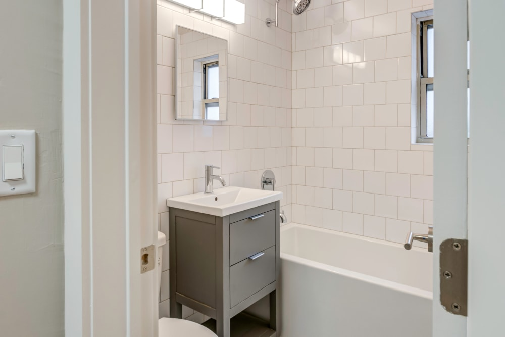 Beautiful modern bathroom with custom tiling in the shower at Haven New Providence in New Providence, New Jersey