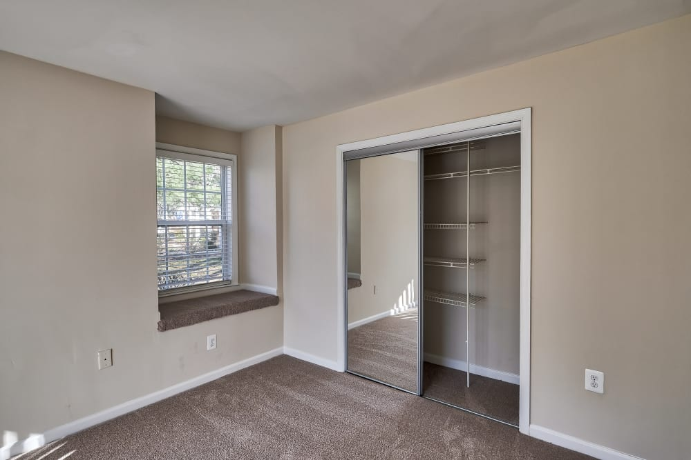 Bedroom with built in window seat at Abbotts Run Apartments in Alexandria, Virginia