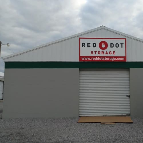 Sign on the outside of a building with units at Red Dot Storage in Springfield, Tennessee