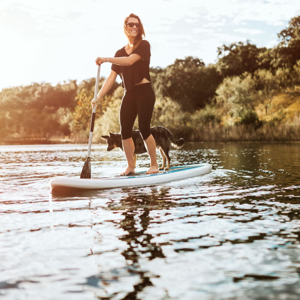 Resident stand-up paddleboarding near Lodge @ 1550 in Katy, Texas