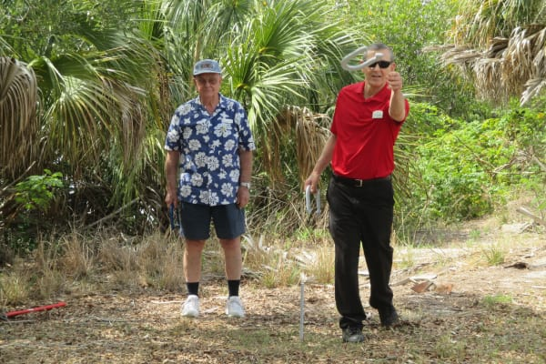 Employees of Discovery Senior Living in Bonita Springs, Florida playing horseshoes at a resident picnic