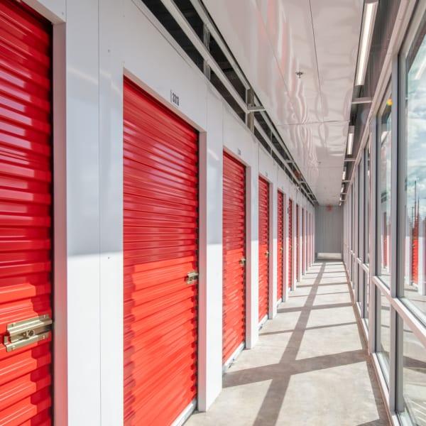 Indoor storage units with bright doors at StorQuest Self Storage in Gardena, California