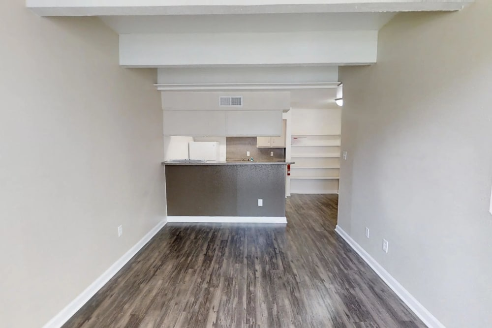 Living room at Falls of Maplewood Apartments
