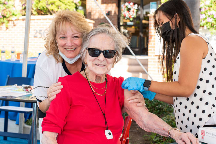 A Bankers Hill resident is all smiles as she gets her COVID-19 Booster Shot.