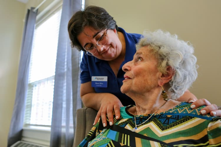 Resident getting help from staff at Harmony at Enterprise in Bowie, Maryland