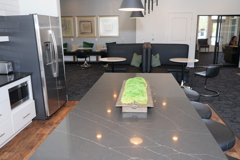 Resident clubhouse kitchen with granite counter top on stool seating Philomath, Oregon near The Boulevard